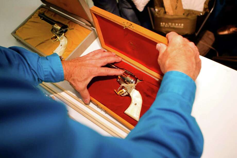 A special gun is checked in Thursday for examination and appraisal at the NRA's Antiques Guns and Gold Showcase at the George R. Brown Convention Center. What is it worth? Photo: Johnny Hanson, Staff / © 2013  Houston Chronicle