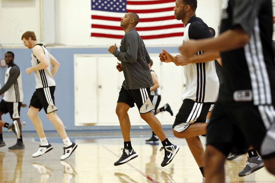 The Spurs' Boris Diaw (center) and teammates run during practice April 27, 2013 at Santa Monica College in Santa Monica, Calif., during their playoff series against the Lakers.