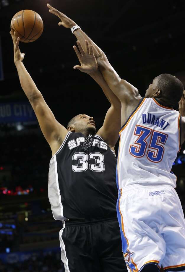 Spurs forward Boris Diaw (33) shoots as Oklahoma City Thunder forward Kevin Durant (35) defends in Oklahoma City on April 4, 2013. Oklahoma City won 100-88.