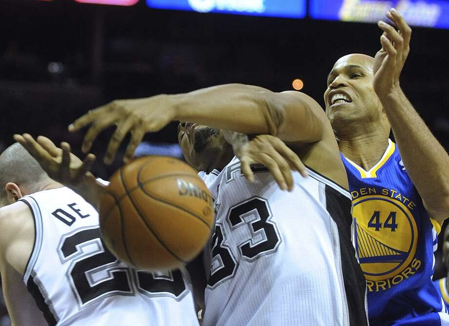 Boris Diaw of the Spurs is tied up by Richard Jefferson (44) of the Golden State Warriors at the AT&T Center on March 20, 2013.