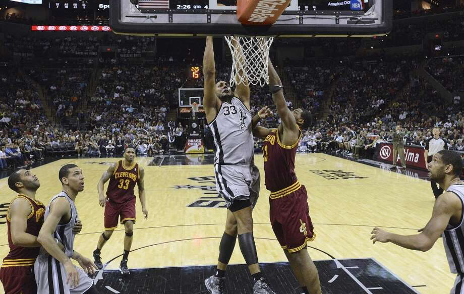 Boris Diaw of the Spurs dunks over Tristan Thompson of the Cleveland Cavaliers at the AT&T Center on March 16, 2013.