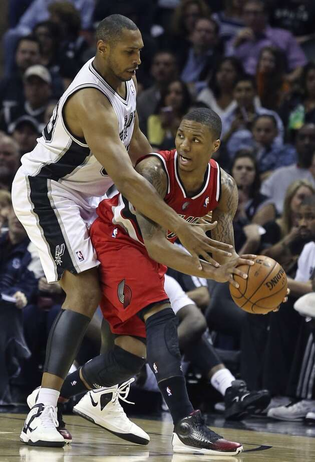 Boris Diaw defends out front against Damian Lillard as the Spurs play the Portland Trailblazers at the AT&T Center on March 8, 2013.