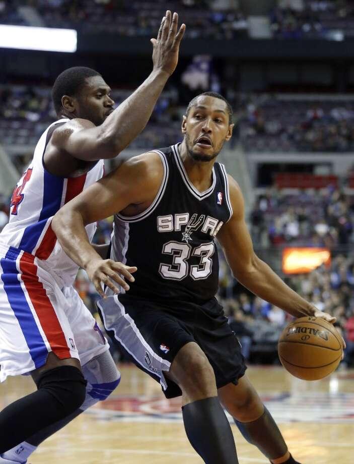 Spurs center Boris Diaw (33) drives against Detroit Pistons forward Jason Maxiell (left) on Feb. 8, 2013, in Auburn Hills, Mich.
