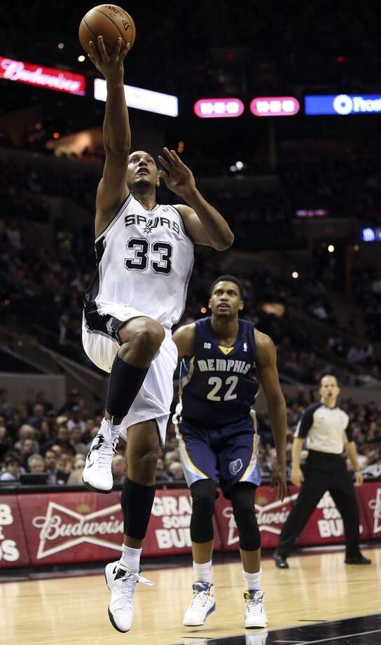The Spurs' Boris Diaw scores over Memphis Grizzlies' Rudy Gay at the AT&T Center on Jan. 16, 2013.