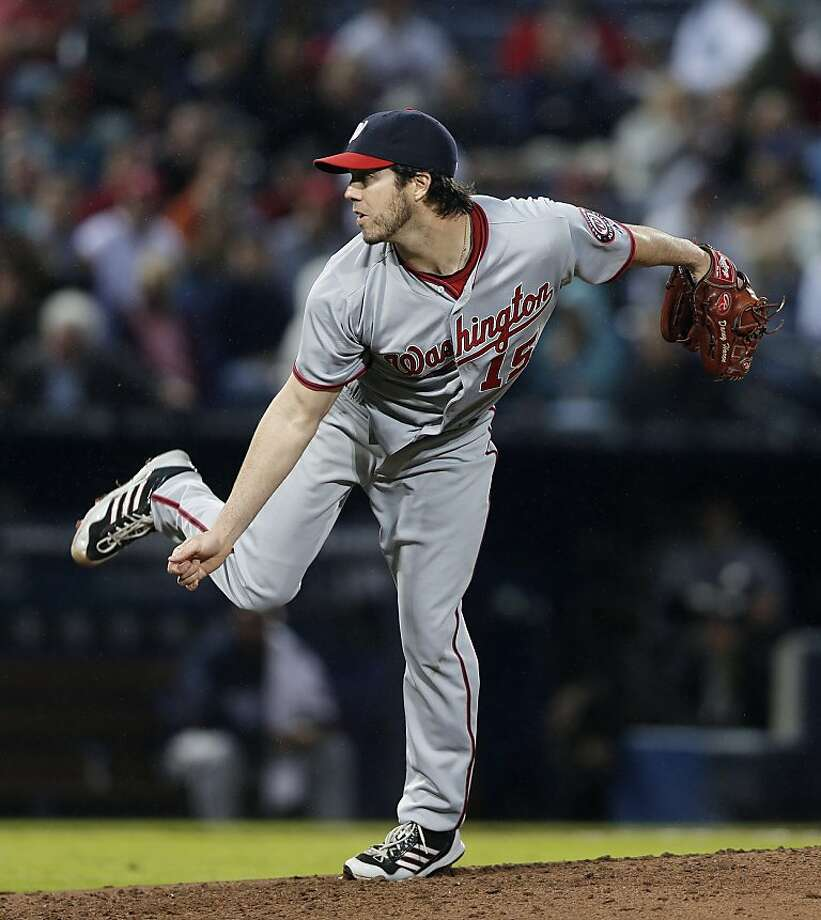 The Giants are most interested in signing starters like Dan Haren (pictured), Bronson Arroyo or Tim Hudson to short-term deals. Photo: John Bazemore, Associated Press