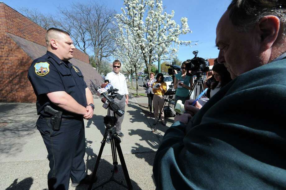 Schenectady Police lieutenant Mark McCracken briefs the media on a fatal fire and shooting on Thursday May 2, 2013 in Schenectady, N.Y. (Michael P. Farrell/Times Union) Photo: Michael P. Farrell