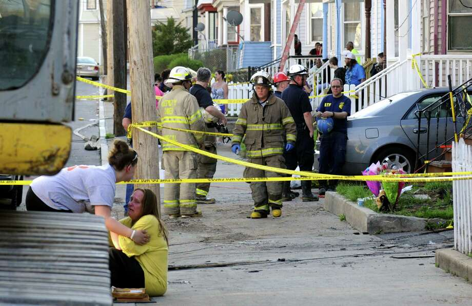 Fire investigators work the scene of a fatal fire at 438 Hulett Street on Thursday May 2, 2013 in Schenectady, N.Y. (Michael P. Farrell/Times Union) Photo: Michael P. Farrell