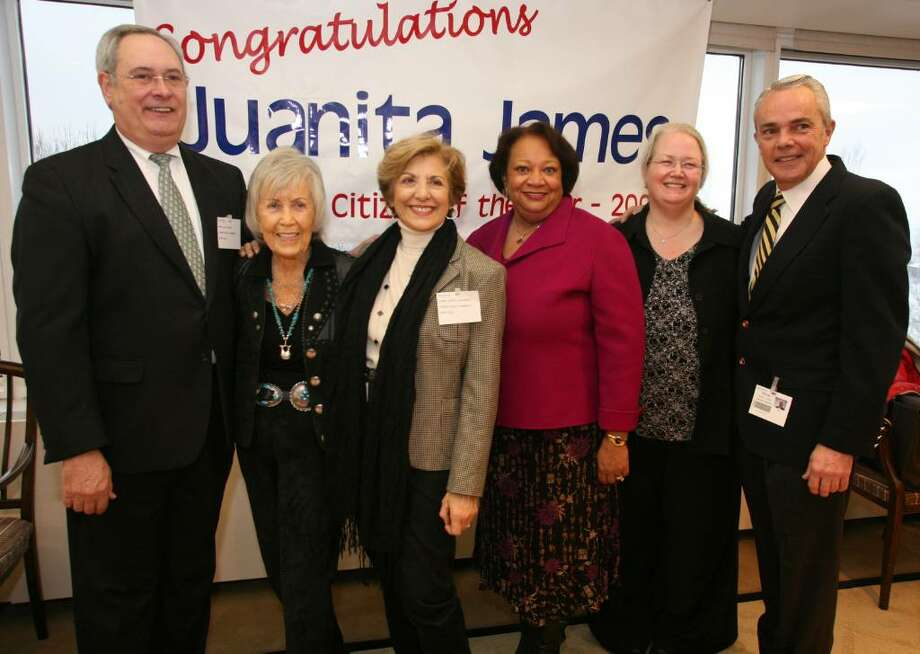 Juanita James (third from right) stands with past Stamford Citizens of the Year Richard Taber '08, June Rosenthal '07, Sandy Goldstein '05, Polly O'Brien Morrow '99, and Michael Cacace '95 during Ms. James Surprise party at the World Headquarters of Pitney Bowes in Stamford. Photo: David Ames, David Ames/For Stamford Advocate / Stamford Advocate