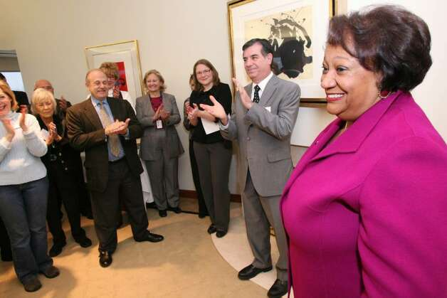 Stamford Citizen of the Year Juanita James is pleasantly surprised Friday morning as she was honored with the award at the Pitney Bowes World Headquarters where she is Chief of Marketing & Communications. Photo: David Ames, David Ames/For Stamford Advocate / Stamford Advocate