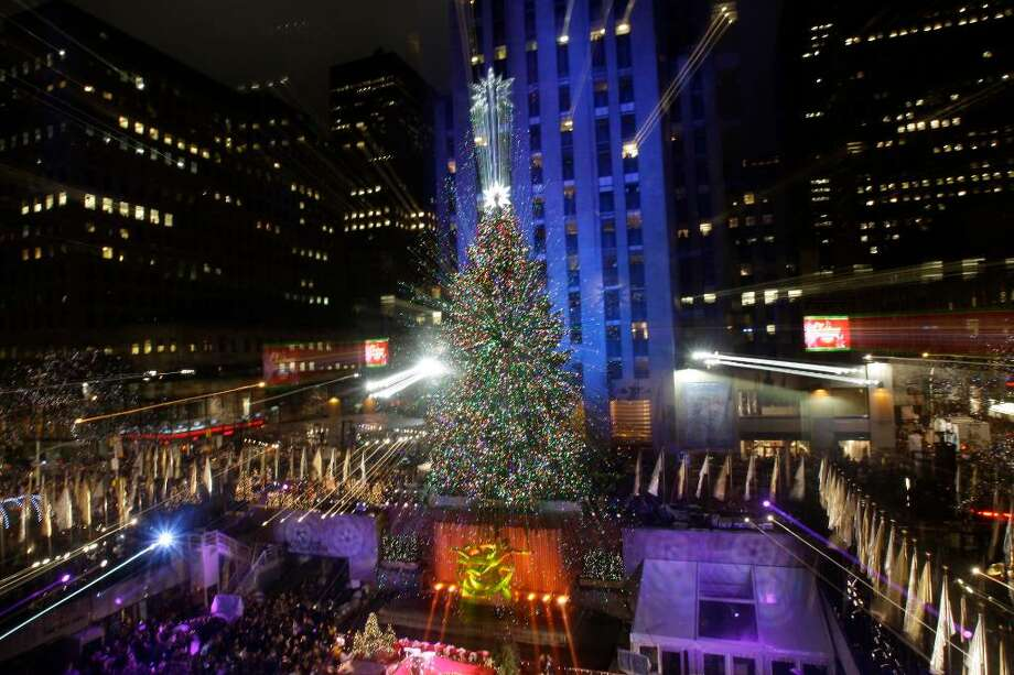 The Rockefeller Center Christmas Tree, which came from Easton CT,  stands lit in front of the General Electric building in New York's Rockefeller Plaza during the 77th annual tree lighting ceremony Wednesday, Dec. 2, 2009  in New York. (AP Photo/Frank Franklin II) Photo: Frank Franklin II, AP / AP