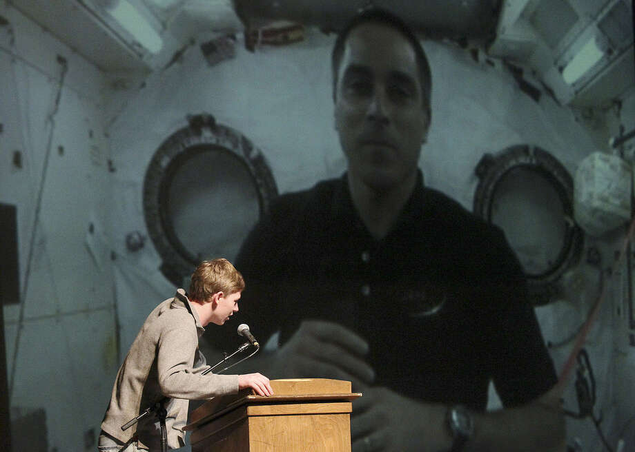 Fredericksburg High School senior Hunter Fries asks a question of International Space Station Commander Chris Cassidy during a special uplink from the Johnson Space Center. Photo: Kin Man Hui / San Antonio Express-News
