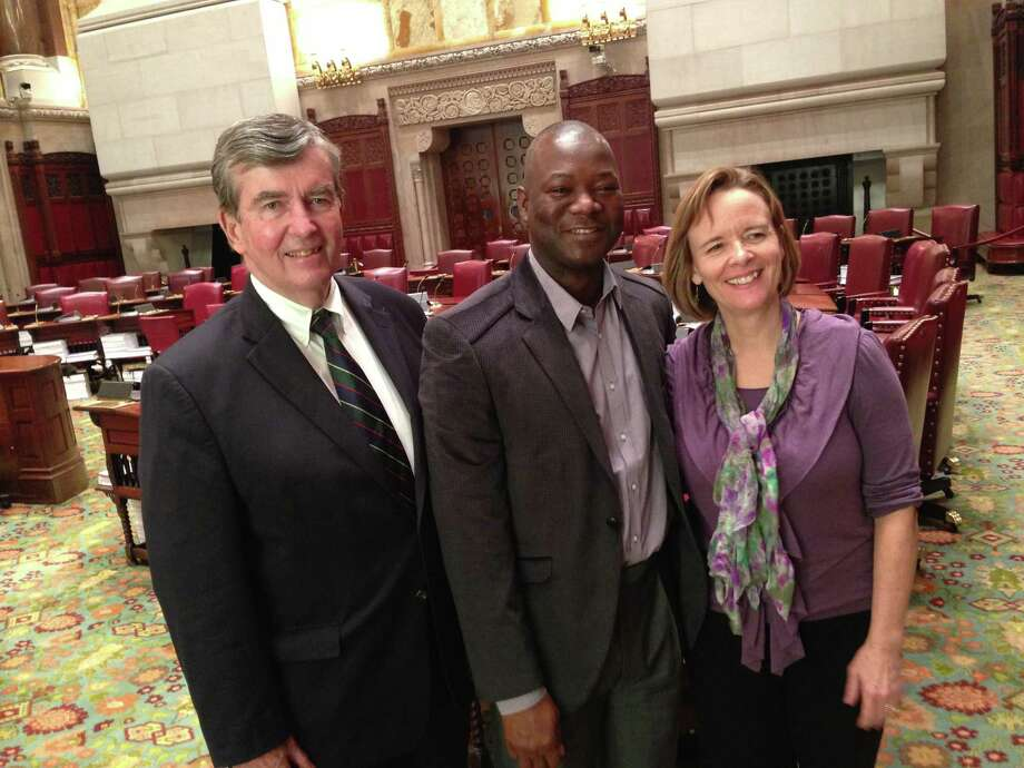 Kaifala Marah, center, visits with Sen. Neil Breslin and Kate Breslin during a recent trip to the New York State Capitol. Marah is now Sierra Leone's minister for finance and economic development. Photo taken 4/25/13. (Casey Seiler/Times Union)