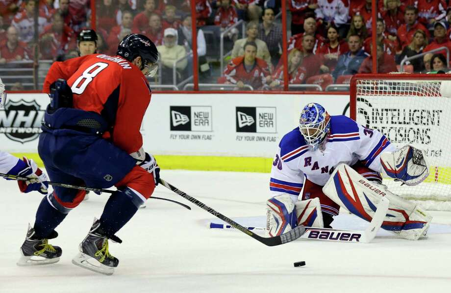Washington Capitals left wing Alex Ovechkin (8), from Russia, prepares to shoot the puck as New York Rangers goalie Henrik Lundqvist (30), from Sweden, prepares to block in the first period of Game 1 of a Stanley Cup NHL playoff hockey series on Thursday, May 2, 2013, in Washington. (AP Photo/Alex Brandon) Photo: Alex Brandon