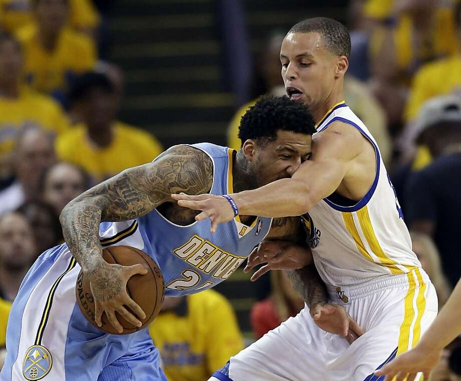 Denver Nuggets' Wilson Chandler, left, drives against Golden State Warriors' Stephen Curry during the first half of Game 6 in a first-round NBA basketball playoff series in Oakland, Calif., Thursday, May 2, 2013. (AP Photo/Marcio Jose Sanchez) Photo: Marcio Jose Sanchez, Associated Press
