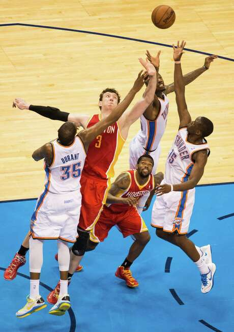 "Rockets center Omer Asik (3) is giving the Thunder fits, even if Kevin Durant (35) has trouble recalling ""whatever his name is."" Photo: Smiley N. Pool, Staff / © 2013  Houston Chronicle"