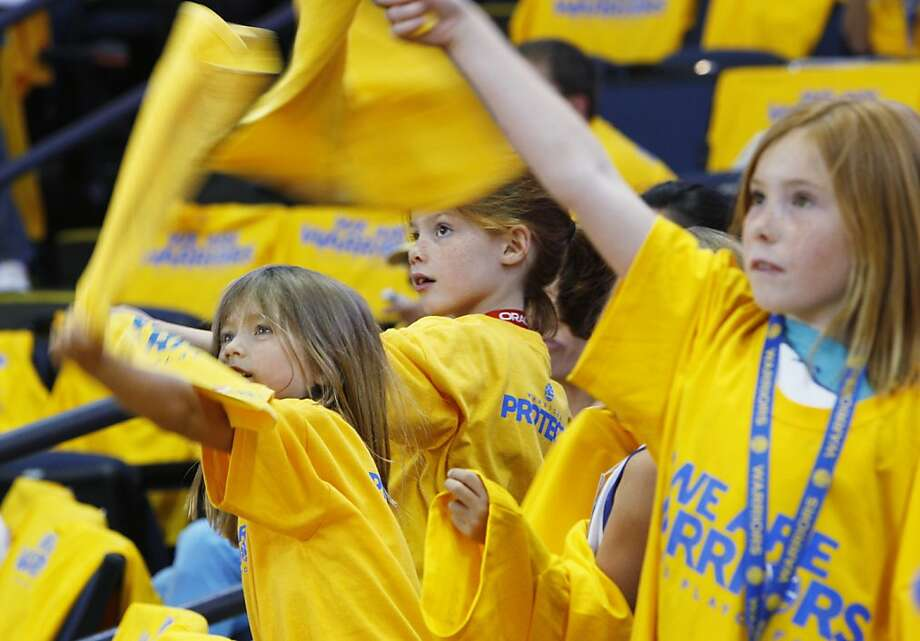 (L-R) Bridey Malone, 6, Clara O'Connor, 5, Julia O'Connor, 7, (partially obscured) and  Caitlin Malone, 8, of Lafayette cheer the team before the game on Thursday. The Golden State Warriors played the Denver Nuggets in Game 6 of the first round of the NBA playoffs at Oracle Arena in Oakland, Calif., on Thursday, May 2, 2013. Photo: Lance Iversen, The Chronicle