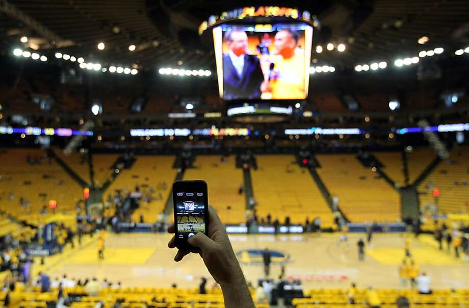 Golden State Warriors fan Uri Paz from Palo Alto Calif, takes a picture of the court prior to the start of game 6 of the first round of the NBA playoffs with the Denver Nuggets at Oracle Arena in Oakland, Calif., on Thursday, May 2, 2013. Photo: Lance Iversen, The Chronicle