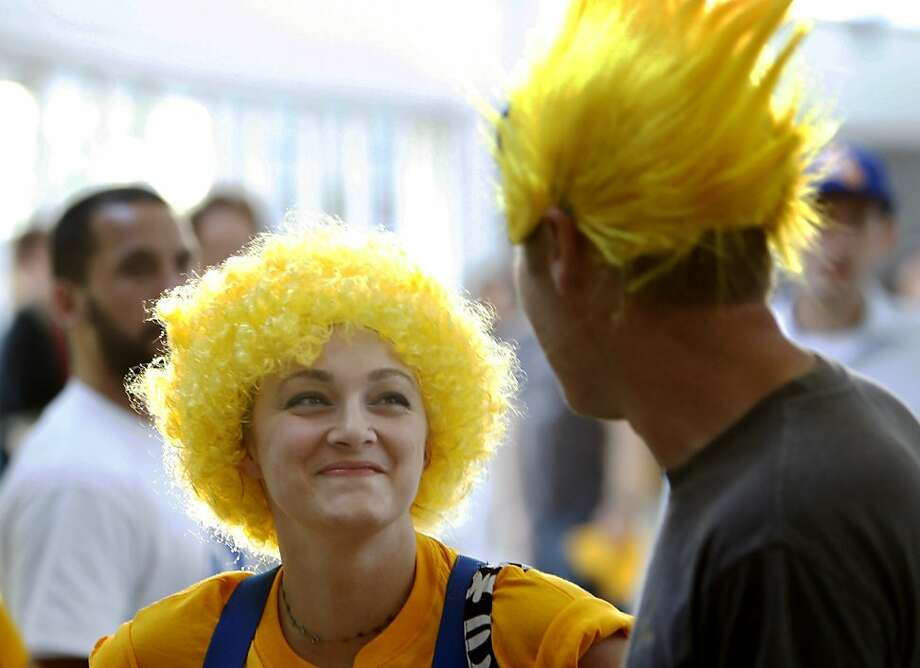 Elizabeth Wood looks up at her boyfriend Ryan Smith (both from Ukiah, before the game on Thursday. The Golden State Warriors played the Denver Nuggets in Game 6 of the first round of the NBA playoffs at Oracle Arena in Oakland, Calif., on Thursday, May 2, 2013. Photo: Lance Iversen, The Chronicle