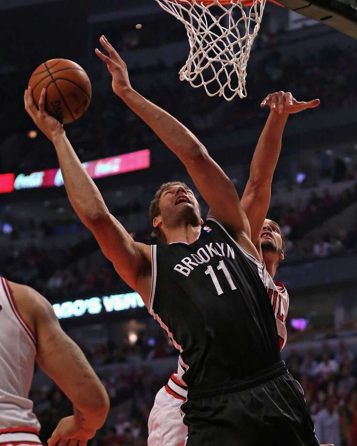 CHICAGO, IL - MAY 02: Brook Lopez #11 of the Brooklyn Nets shoots past Joakim Noah #13 of the Chicago Bulls in Game Six of the Eastern Conference Quarterfinals during the 2013 NBA Playoffs at the United Center on May 2, 2013 in Chicago, Illinois. NOTE TO USER: User expressly acknowledges and agrees that, by downloading and or using this photograph, User is consenting to the terms and conditions of the Getty Images License Agreement. (Photo by Jonathan Daniel/Getty Images) Photo: Jonathan Daniel