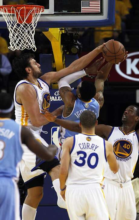 Andrew Bogut, blocking Denver's Andre Iguodala, gave the Warriors a lot: 14 points, 21 rebounds, 4 blocks, 3 assists. Photo: Lance Iversen, The Chronicle