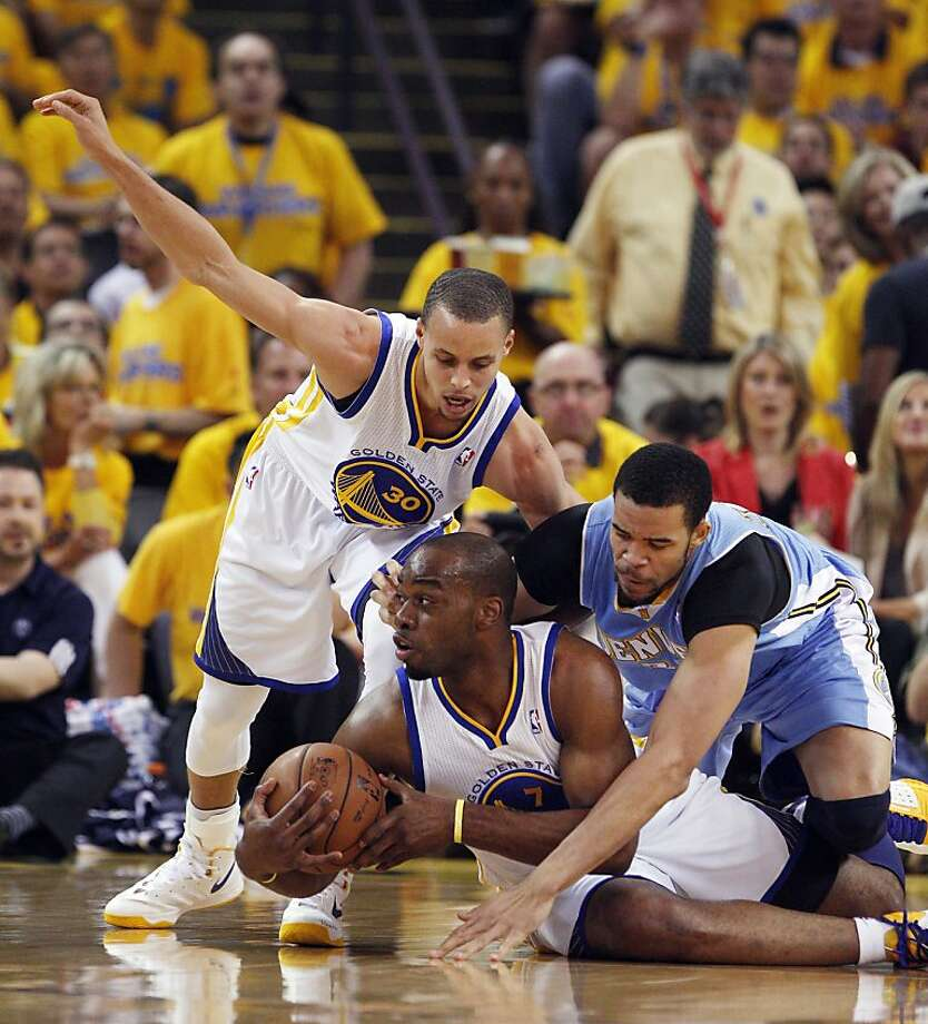 Carl Landry holds onto a loose ball in the first half of the Warriors' up-and-down win over Denver. Photo: Lance Iversen, The Chronicle