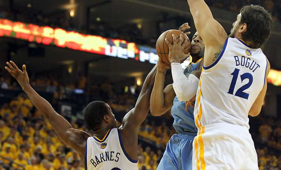 Harrison Barnes and Andrew Bogut of the Golden State Warriors block Denver Nuggets Danilo Gallinari from shooting in Game 6 of the first round of the NBA playoffs at Oracle Arena in Oakland, Calif., on Thursday, May 2, 2013. Photo: Lance Iversen, The Chronicle