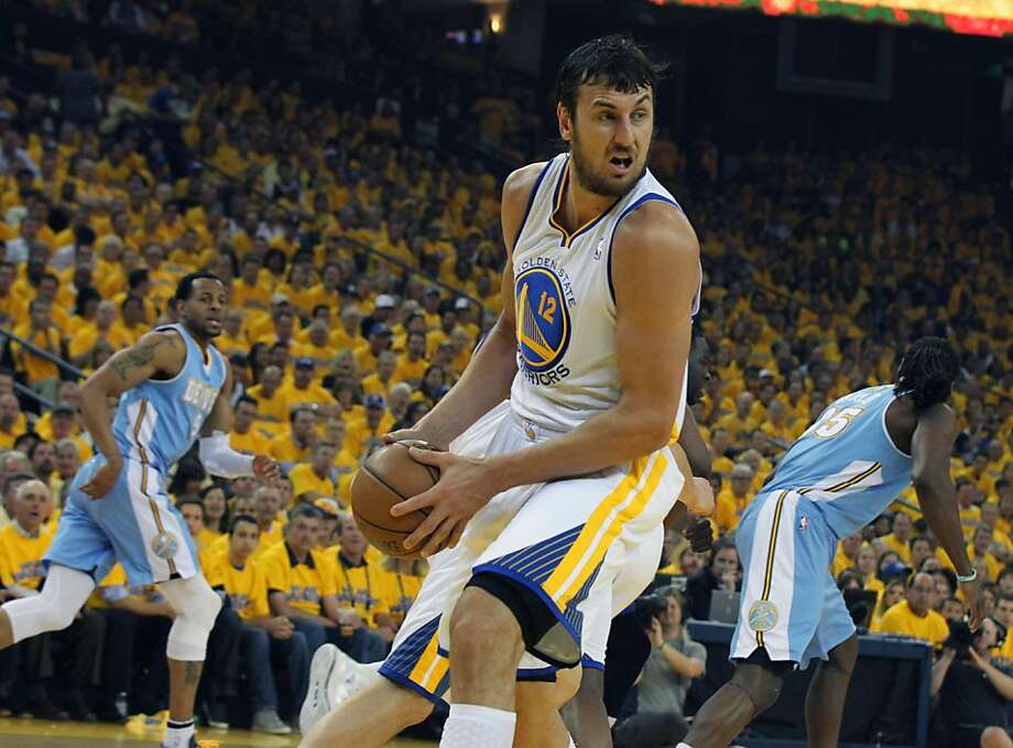 Andrew Bogut of the Golden State Warriors pulls down a rebound in Game 6 of the first round of the NBA playoffs with the Denver Nuggets at Oracle Arena in Oakland, Calif., on Thursday, May 2, 2013. Photo: Lance Iversen, The Chronicle