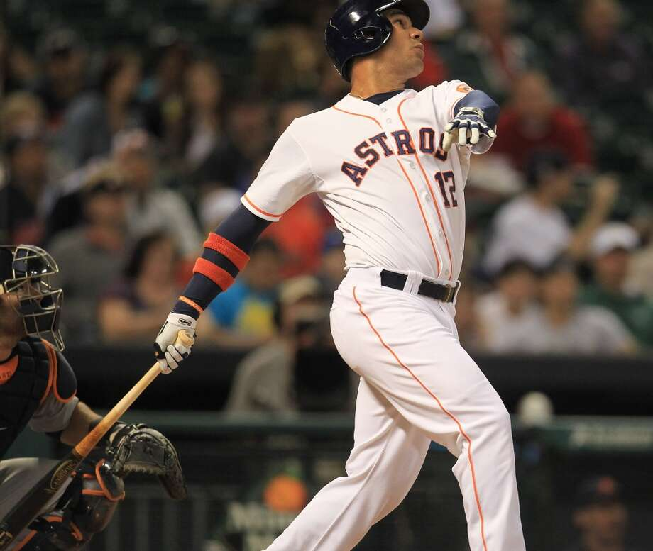 Astros first baseman Carlos Pena hits a home run in the fourth inning. Photo: Karen Warren, Houston Chronicle
