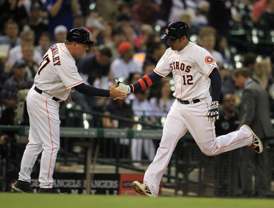 Astros first baseman Carlos Pena rounds the bases after his home run.