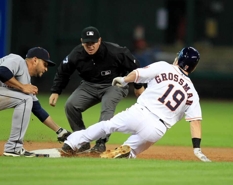 Astros center fielder Robbie Grossman slides into second base with a double in the first inning. Photo: Karen Warren, Houston Chronicle