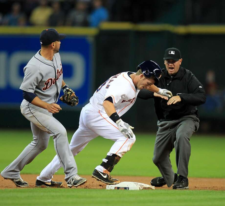 Astros center fielder Robbie Grossman slides into second base with a double in the first inning.