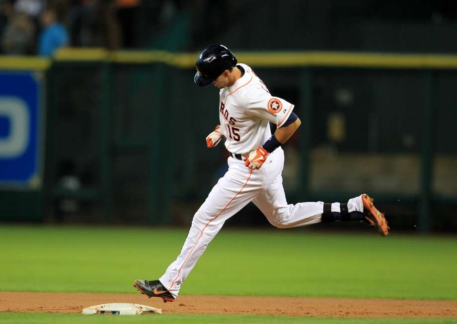 Astros catcher Jason Castro circles the bases after his two-run home run in the first inning. Photo: Karen Warren, Houston Chronicle