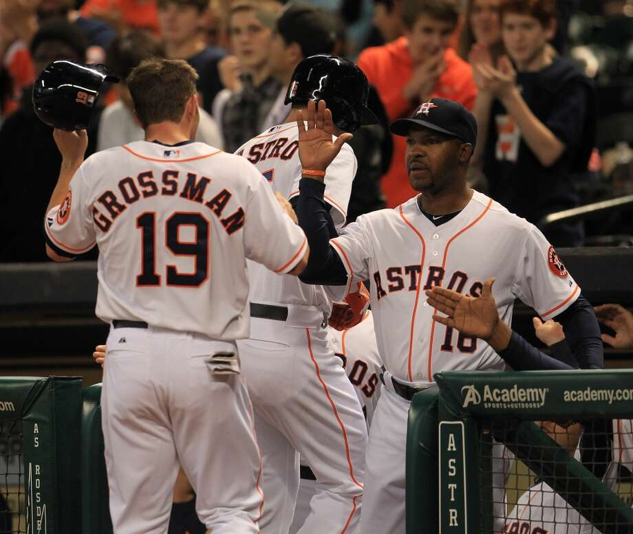 Astros manager Bo Porter congratulates catcher Jason Castro and Astros center fielder Robbie Grossman after Castro's  two-run home run.