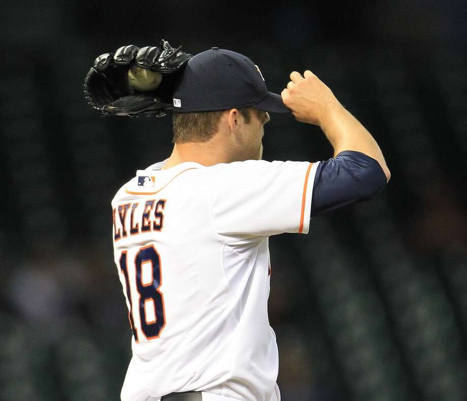 Astros starting pitcher Jordan Lyles reacts after giving up a run in the third inning.