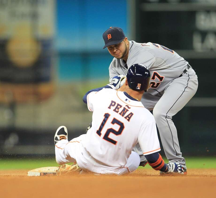 Astros first baseman Carlos Pena is out at second after trying to stretch a fielding error into extra bases in the seventh inning. Photo: Karen Warren, Houston Chronicle
