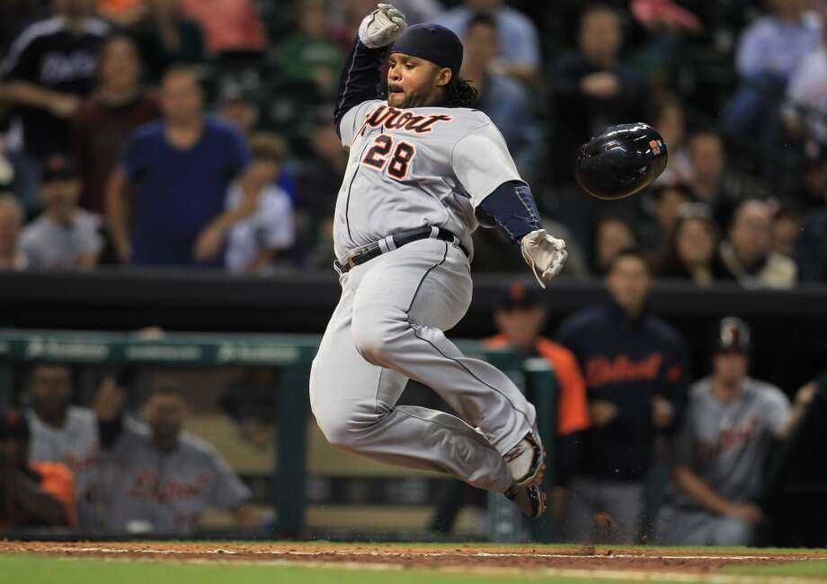 Tigers first baseman Prince Fielder dives into home safely in the eighth inning.