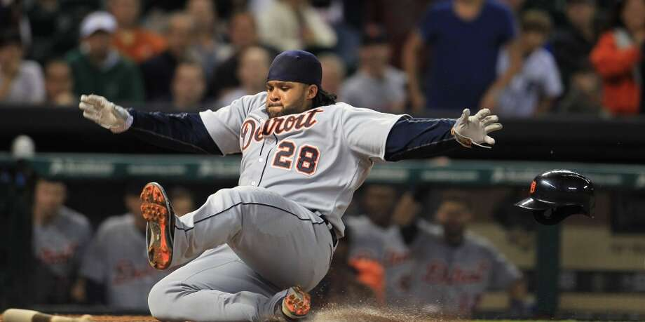Tigers first baseman Prince Fielder dives into home safely in the eighth inning. Photo: Karen Warren, Houston Chronicle