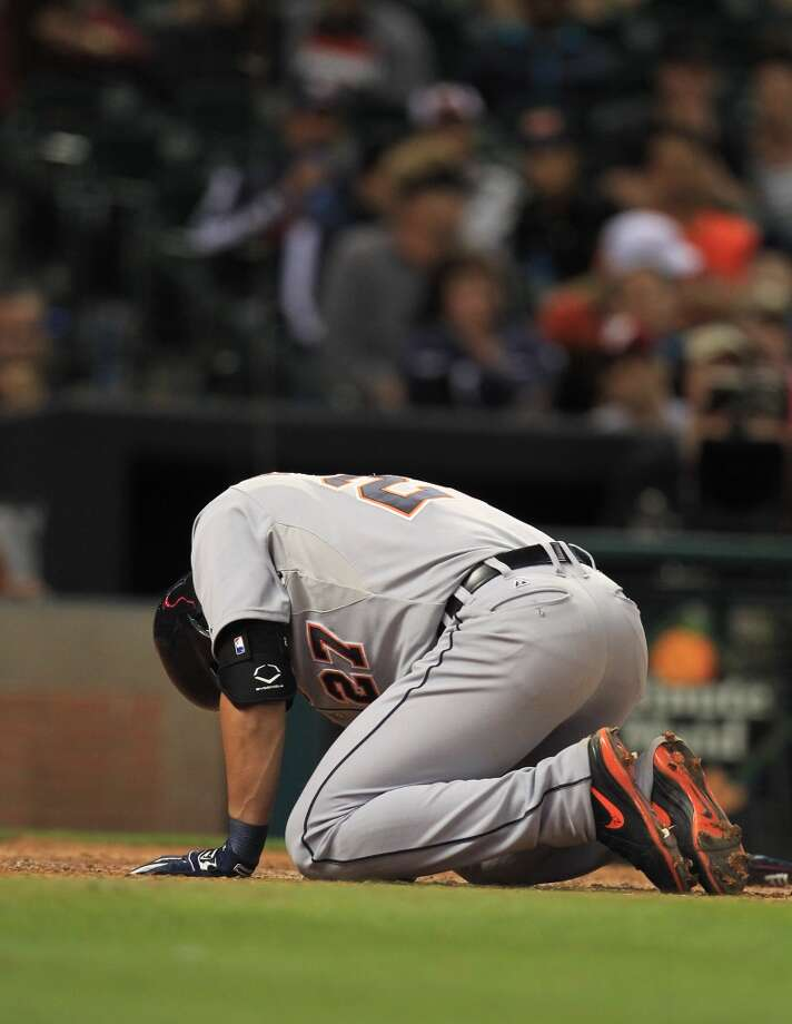 Tigers shortstop Jhonny Peralta reacts after getting hit by a foul ball. Photo: Karen Warren, Houston Chronicle