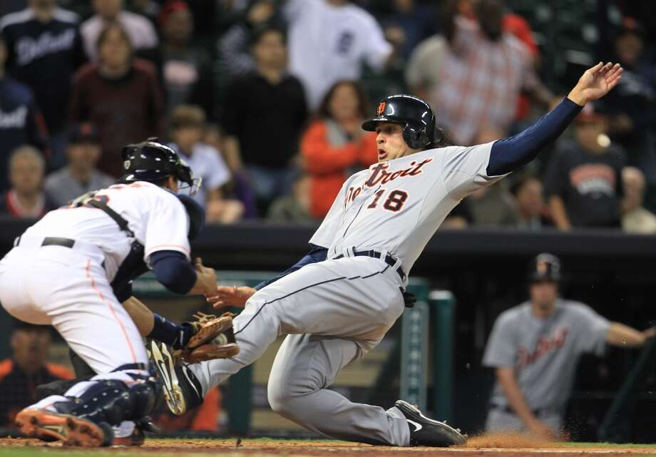 Tigers shortstop Matt Tuiasosopo gets thrown out at home in the eleventh inning. Photo: Karen Warren, Houston Chronicle