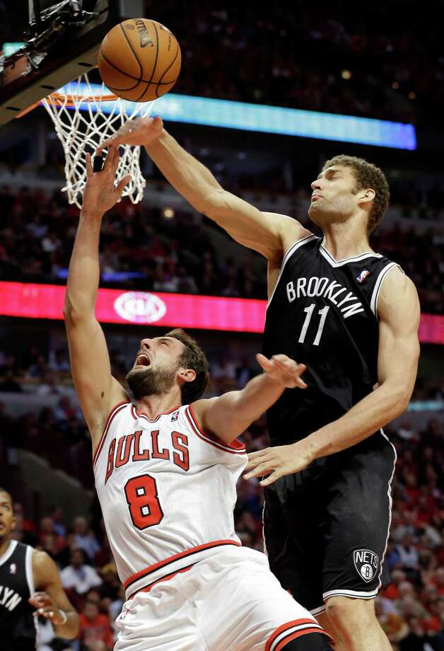 Nets center Brook Lopez blocks a shot by Bulls guard Marco Belinelli in the second half Thursday night. Photo: Nam Y. Huh, STF / AP