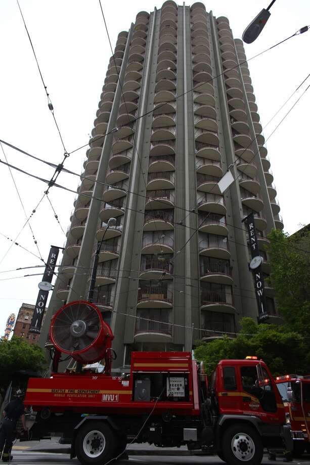 A large Seattle Fire fan truck ventilates a building after a garbage chute fire in the 30 story building filled the tower with smoke on Thursday, May 2, 2013.