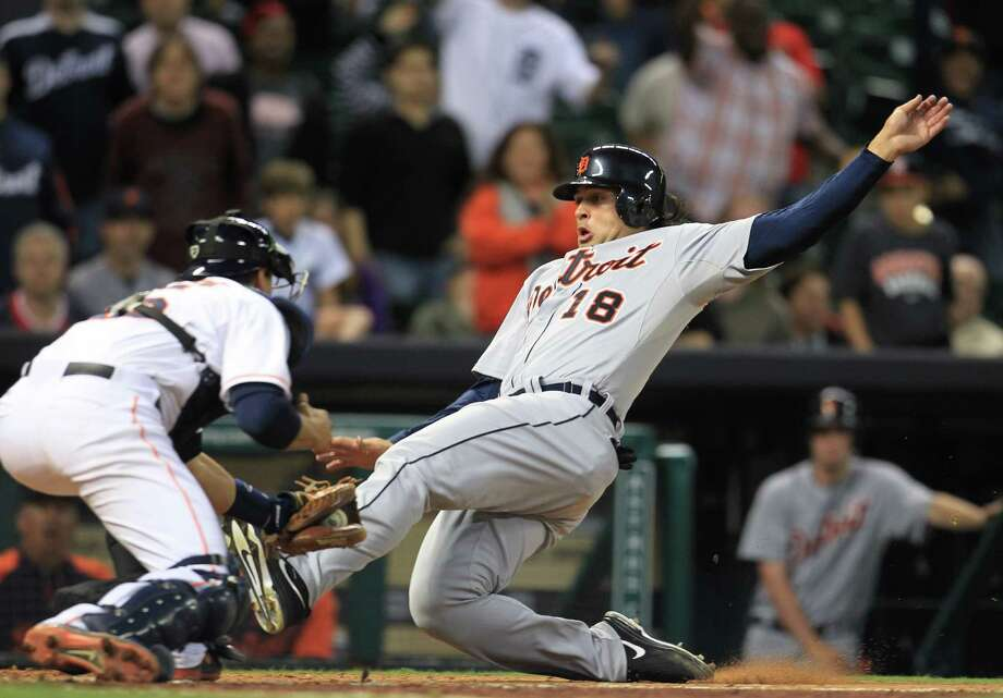 Tigers shortstop Matt Tuiasosopo is tagged out by Astros catcher Jason Castro after a strike from right fielder Rick Ankiel in the 11th inning of the Tigers' 7-3 win in 14 innings Thursday night at Minute Maid Park. Photo: Karen Warren, Staff / © 2013 Houston Chronicle