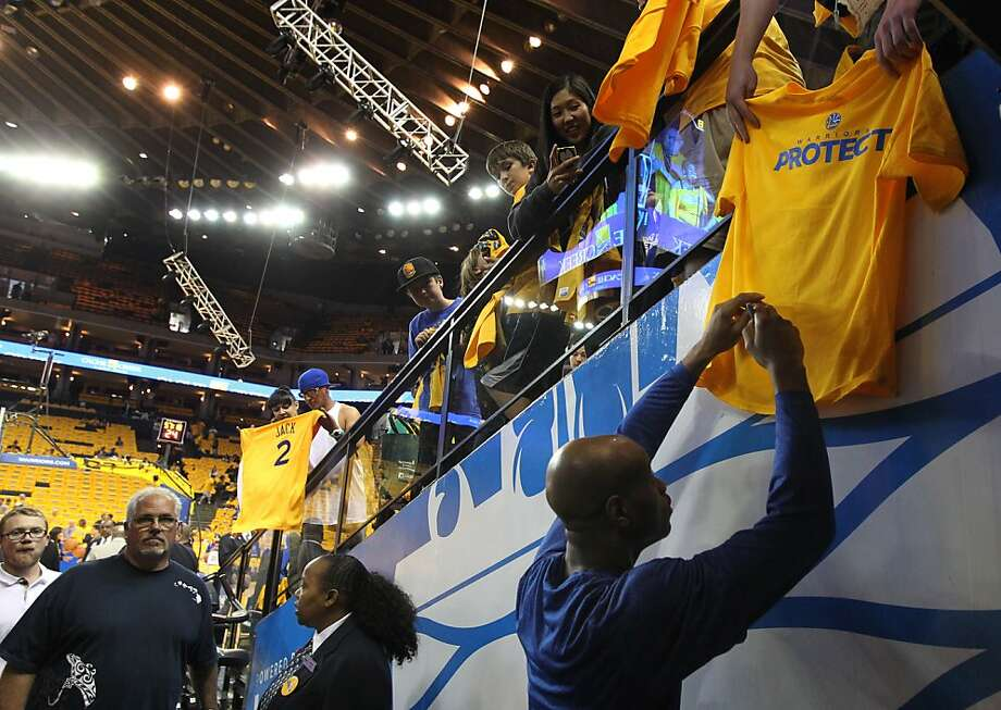 Jarrett Jack of the Golden State Warriors signs autographs for fans prior to Game 6 of the first round of the NBA playoffs with the Denver Nuggets in Oakland, Calif., on Thursday, May 2, 2013. Photo: Lance Iversen, The Chronicle