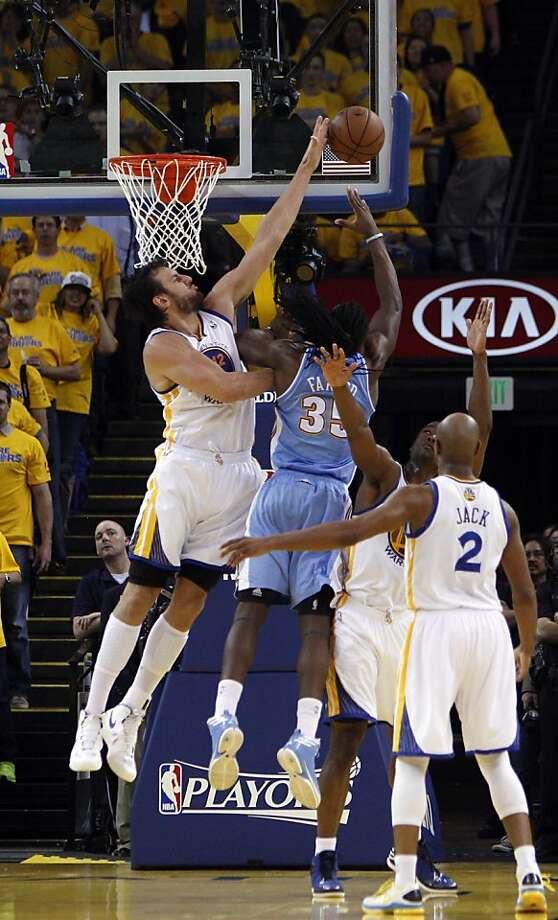 Andrew Bogut (12) blocks a shot by Kenneth Faried (35) in the first half on Thursday. The Golden State Warriors played the Denver Nuggets in Game 6 of the first round of the NBA playoffs at Oracle Arena in Oakland, Calif., on Thursday, May 2, 2013. Photo: Carlos Avila Gonzalez, The Chronicle