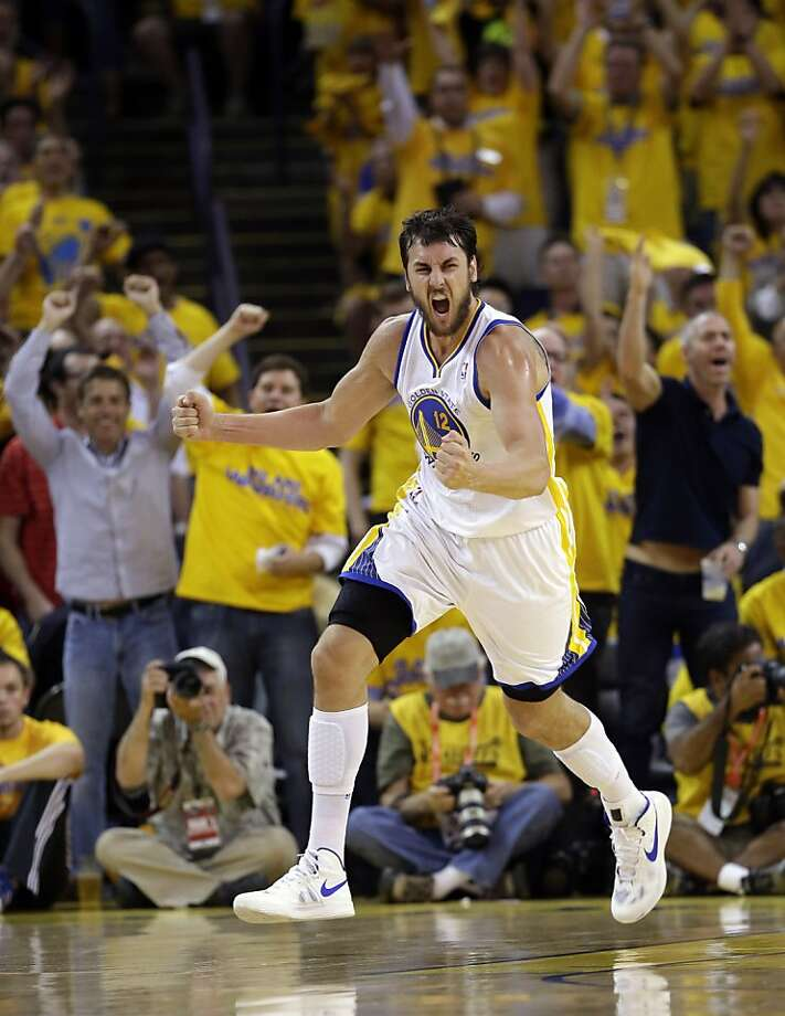 Golden State Warriors' Andrew Bogut celebrates after scoring against the Denver Nuggets during the second half of Game 6 in a first-round NBA basketball playoff series in Oakland, Calif., Thursday, May 2, 2013. Golden State won 92-88. (AP Photo/Marcio Jose Sanchez) Photo: Marcio Jose Sanchez, Associated Press