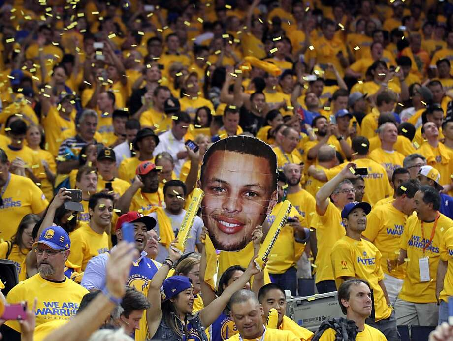 Golden State Warriors fans celebrate their 92-88 win over the Denver Nuggets in Game 6 of the first round of the NBA playoffs at Oracle Arena in Oakland, Calif., on Thursday, May 2, 2013. Photo: Lance Iversen, The Chronicle