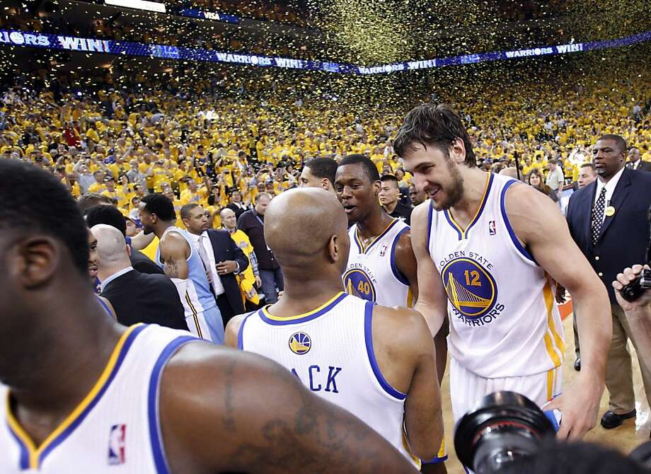 The Warriors celebrate after defeating the Nuggets and advancing to the next round of the playoffs on Thursday. The Golden State Warriors played the Denver Nuggets in Game 6 of the first round of the NBA playoffs at Oracle Arena in Oakland, Calif., on Thursday, May 2, 2013. Photo: Carlos Avila Gonzalez, The Chronicle