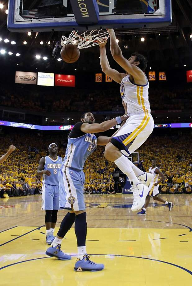 Andrew Bogut (12) dunks the ball over JaValle McGee (34) in the second half of the game on Thursday. The Golden State Warriors played the Denver Nuggets in Game 6 of the first round of the NBA playoffs at Oracle Arena in Oakland, Calif., on Thursday, May 2, 2013. Photo: Carlos Avila Gonzalez, The Chronicle