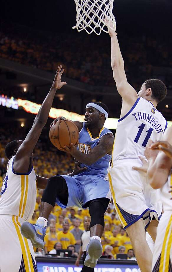 Ty Lawson (3) tries to pass the ball under the basket in the second half of the game on Thursday. The Golden State Warriors played the Denver Nuggets in Game 6 of the first round of the NBA playoffs at Oracle Arena in Oakland, Calif., on Thursday, May 2, 2013. Photo: Carlos Avila Gonzalez, The Chronicle