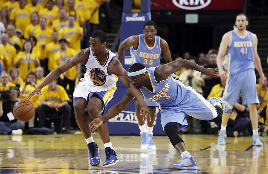 Harrison Barnes (40) drives the perimeter defended by Ty Lawson (3) in the second half of the game on Thursday. The Golden State Warriors played the Denver Nuggets in Game 6 of the first round of the NBA playoffs at Oracle Arena in Oakland, Calif., on Thursday, May 2, 2013. Photo: Carlos Avila Gonzalez, The Chronicle